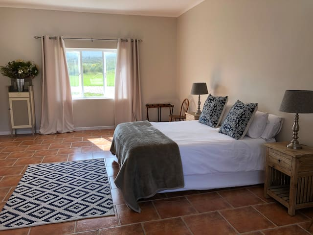The third bedroom is extremely large and spacious as well as privately situated at the end of the long corridor. It has a queen-size bed and desk to work at if you require. It also boasts a walk-in wardrobe.