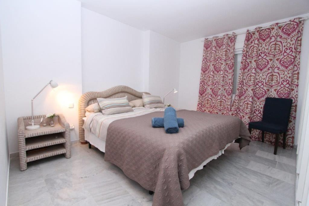 Large master bedroom with ensuite bathroom, private pation and private terrace with pool and mountain view