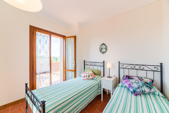 First floor: Bedroom 2 with 2 single/joinable beds has direct access to the panoramic terrace