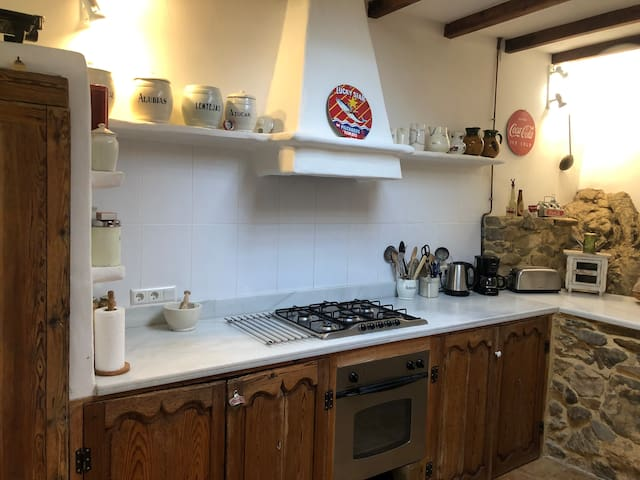 Our well-equipped kitchen has marble work tops, a large fridge freezer, gas hobs, electric oven along with kettle toaster and coffee machine.