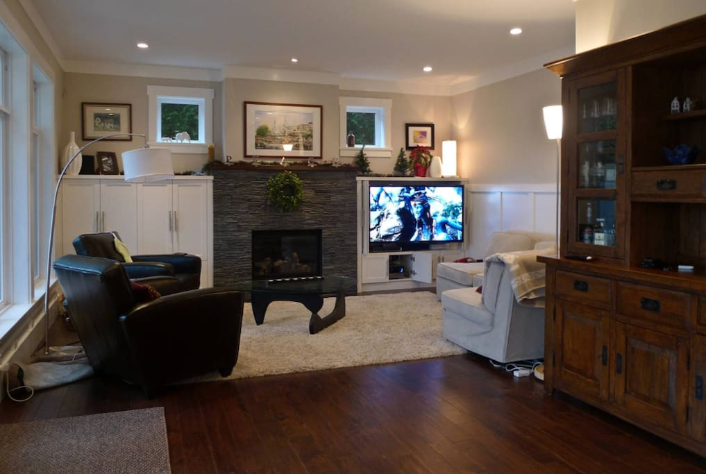 "Livingroom view from kitchen - 55"" TV and gas fireplace in view."