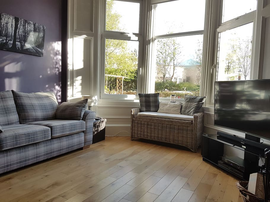 Front room with south facing sunny bay window