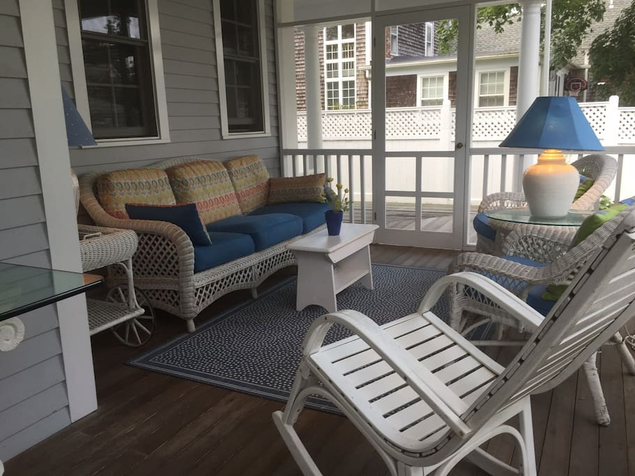 Screened porch sitting area is a wonderful retreat