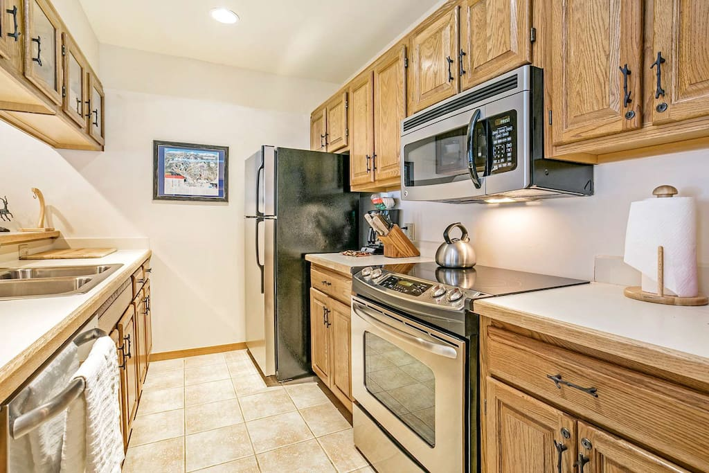 Enjoy creating meals in this fully equipped kitchen with stainless appliances.