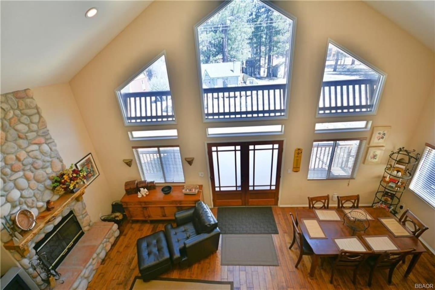 Cathedral ceiling, lightly and airy open concept living room/kitchen area with extensive social and communal space to build your mountain family memories (view from Game Room)