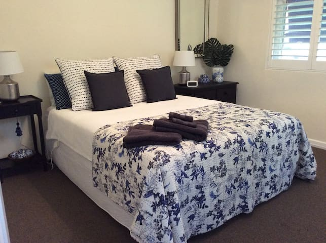 Master bedroom with comfy QS bed and lovely linens. Wardrobe, drawers and plenty of room.
