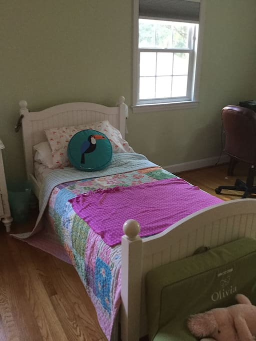 Well lit large bedroom perfect for kids. Twin air mattress available upon request