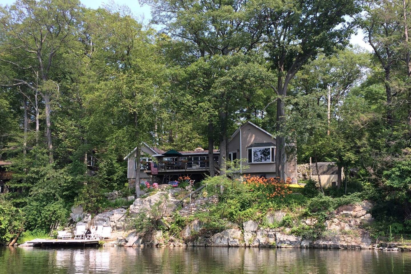 My favorite picture of the house from the lake. I didn't realize it but I'm actually in this picture on the dock on a chair.