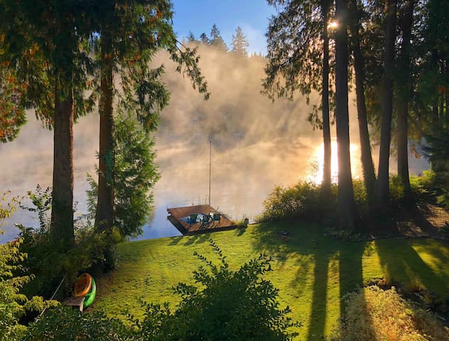Wake up to this! The tiny house has access to a shared waterfront space, use of our dock, firepit and 2 kayaks. This space is shared between three separate cottages on the property.