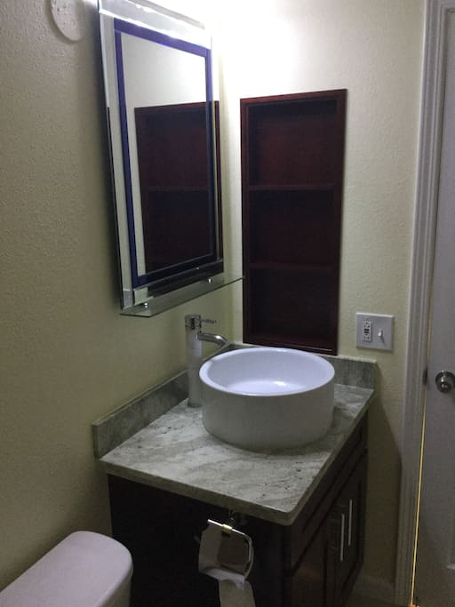 granite top counter with new vanity mirror and cabinet
