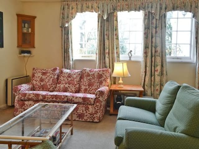 South facing sitting room with 3  and 2 seater sofa and arm chair