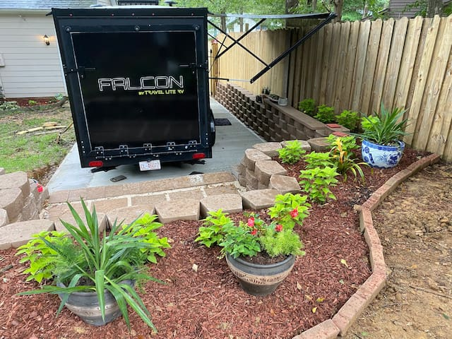 Travel trailer in Charlotte with secluded backyard