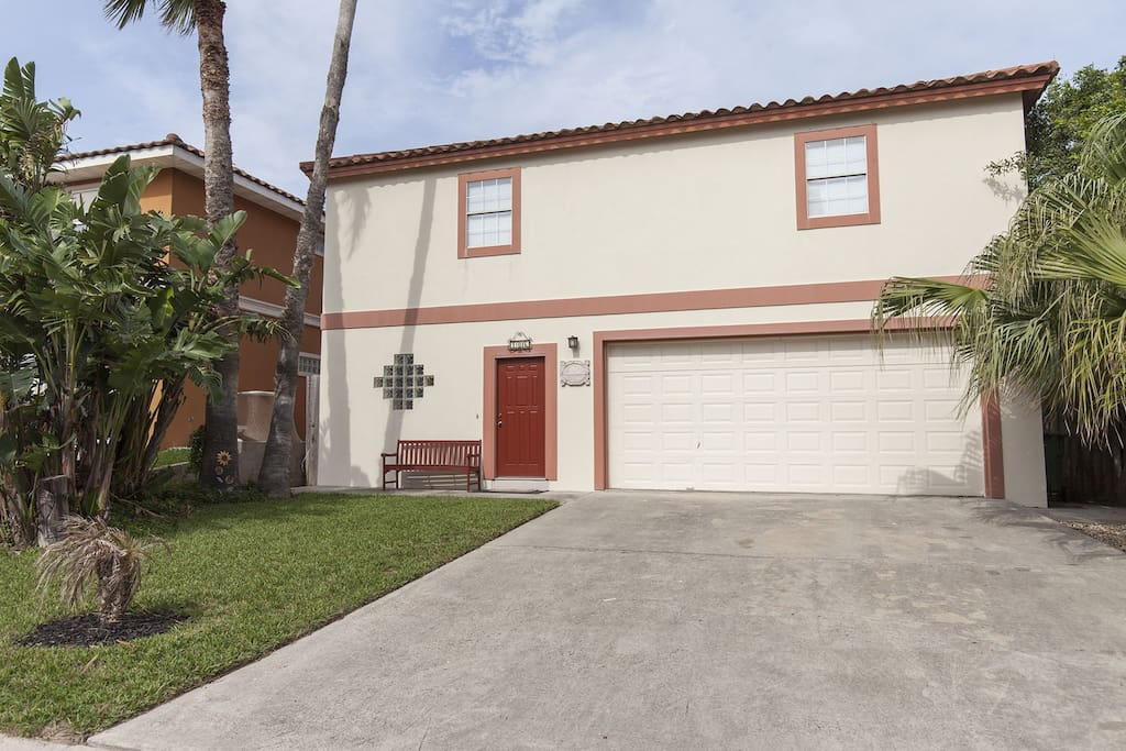 Classic Spanish style home with large driveway and garage