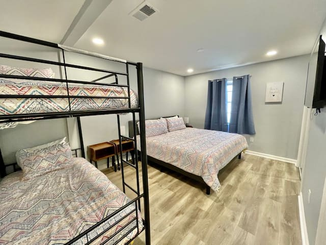 Third bedroom - king size bed and a twin over twin bunk, sleeps 4. Private bathrooms and smart TV