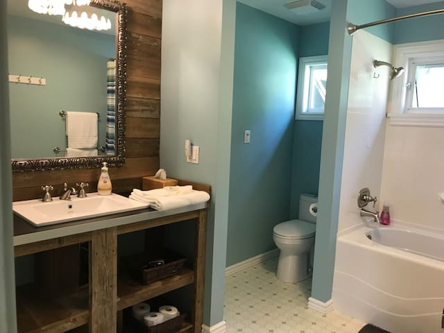 Make it a spa day in the large and private 3-piece bath with reclaimed wood vanity
