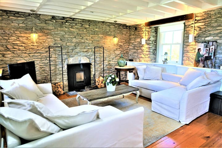 cozy around the fire place in the lounge area with 2 L shaped couch beds with curtains for privacy