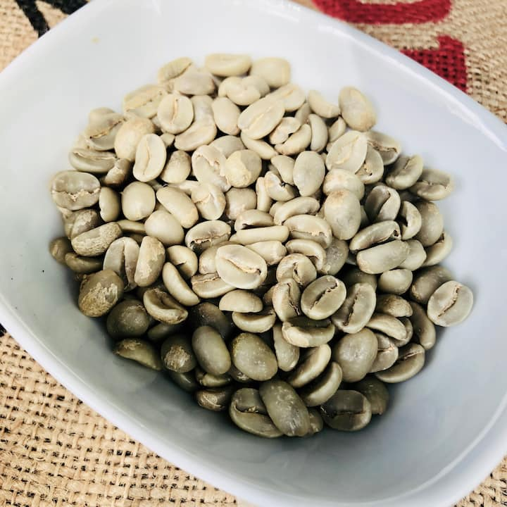 Unroasted, green coffee beans