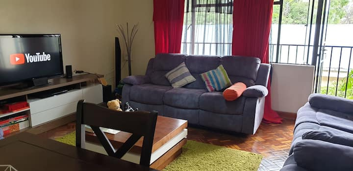 Cozy and warm room in a Kilimani apartment.