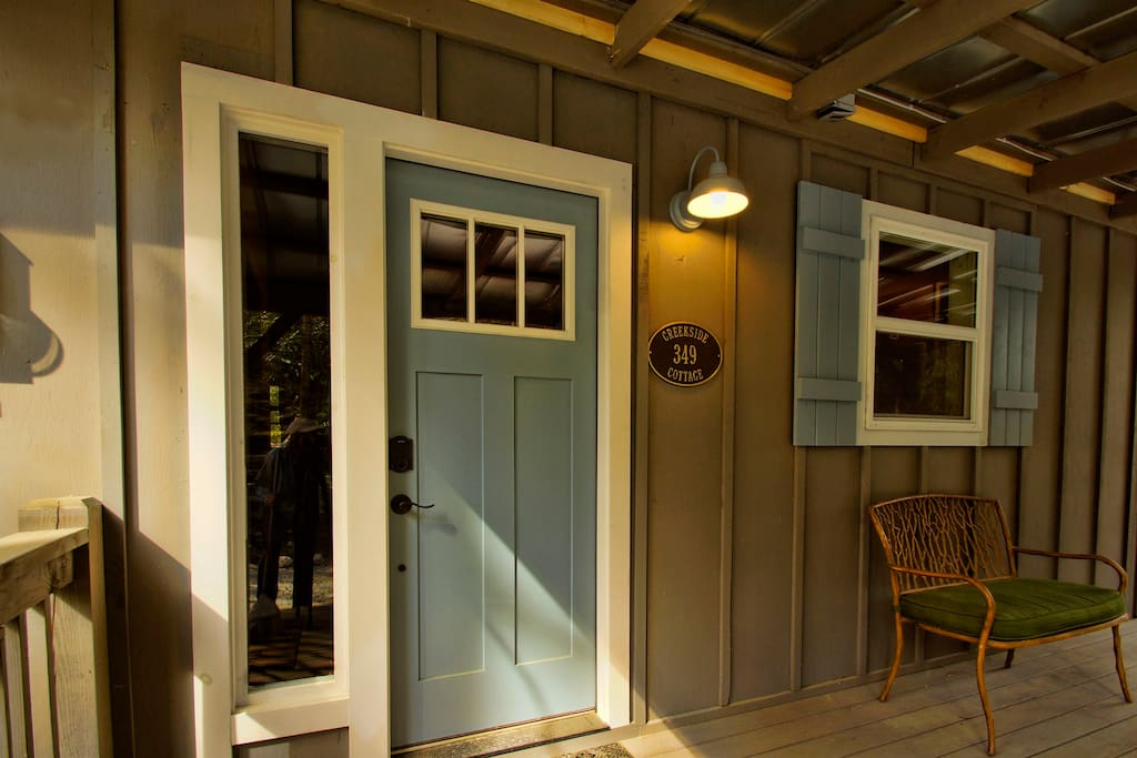 A well lite front porch is inviting you to step in and Welcome Home.
