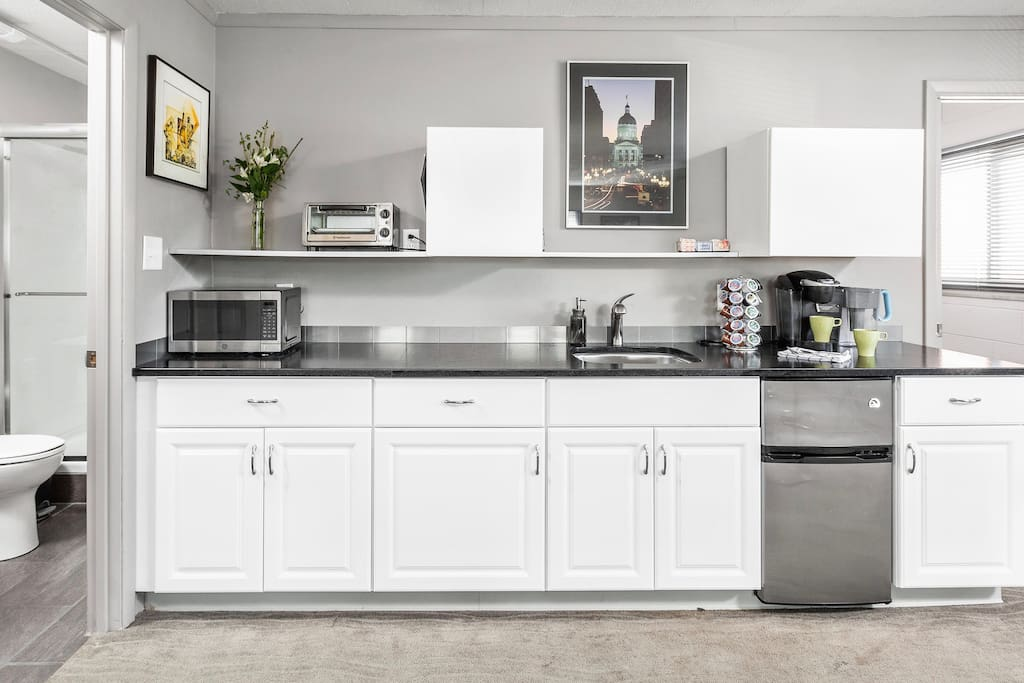 Efficiency kitchen completely outfitted with dining and cooking utensils