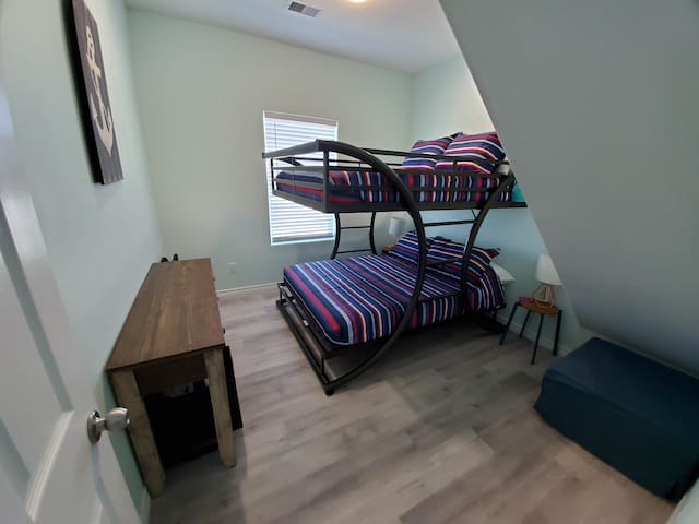 Bedroom 4 with Full over Full bunkbed and twin hide a bed ottoman