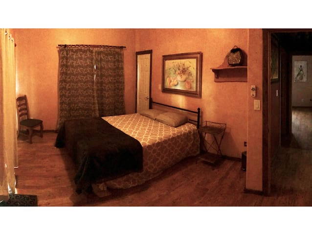Bedroom 3 panorama. Original artwork can be found throughout the cabin.