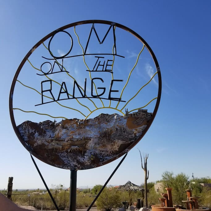 Artist Om on the Range sign located at corner of Superstition Blvd and North Mountain View Road, Artist US Air Force veteran Farron Leep