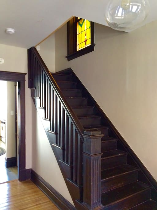 Original stair case & stained glass window.
