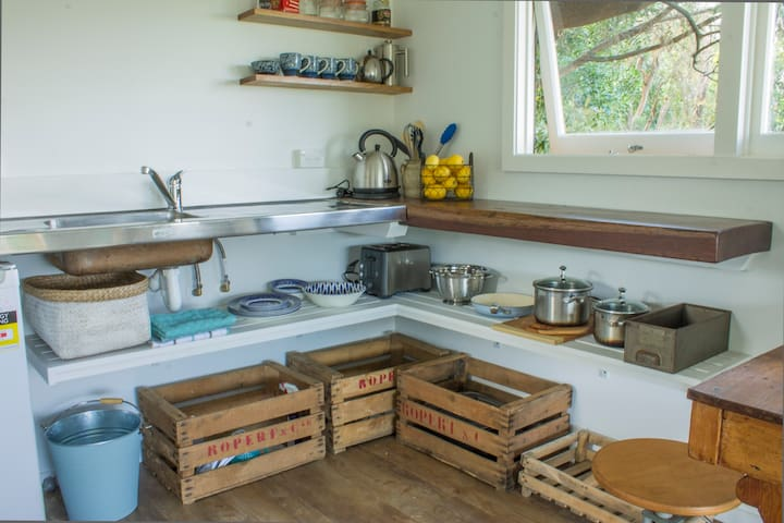 A fully equipped kitchen with stove top and fridge which aren't in this shot.