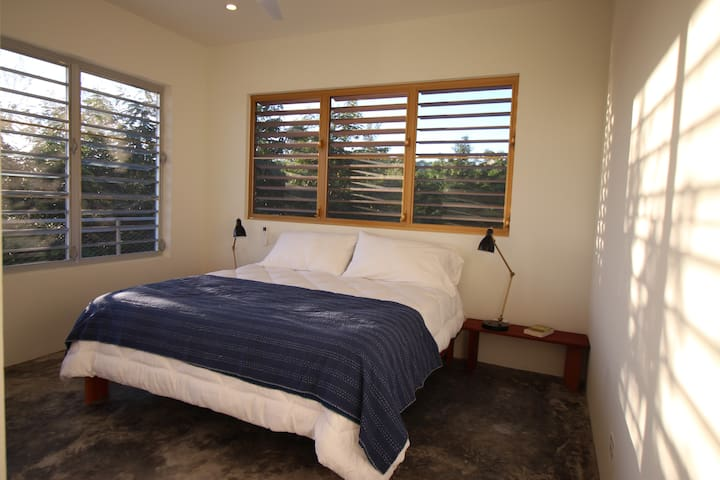 Bedroom #2 with king bed, private bathroom and ocean views