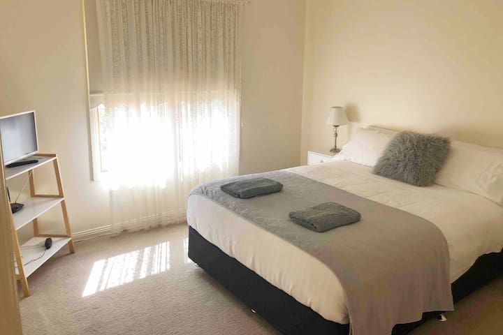 Queen size bed with TV and DVD  player. Large walk in robe.