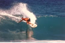 Surf in warm, clear water all year long