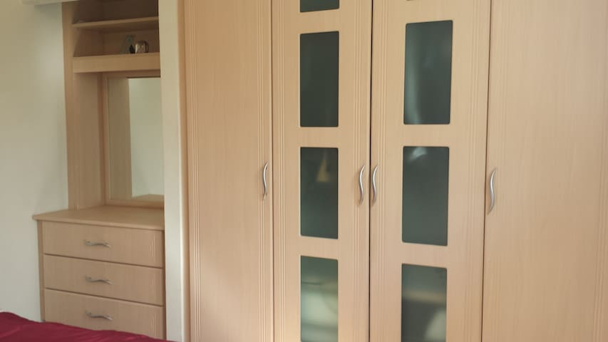 A spacious double room ina family house of couple.