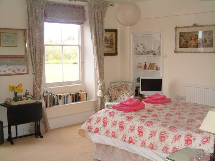 The Pink Room (£90/night). En-suite bath and with views over the lake to the rear of the house.