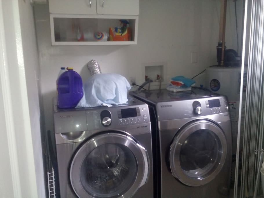 Washer, Dryer, ironing board, jacuzzi, shower, tub, private bath.