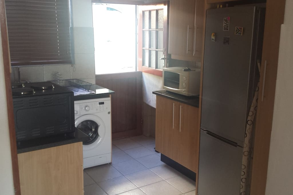 Kitchen with washing machine and dryer