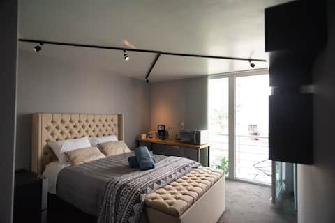 Super comfortable double bed, cable TV,   with private balcony.