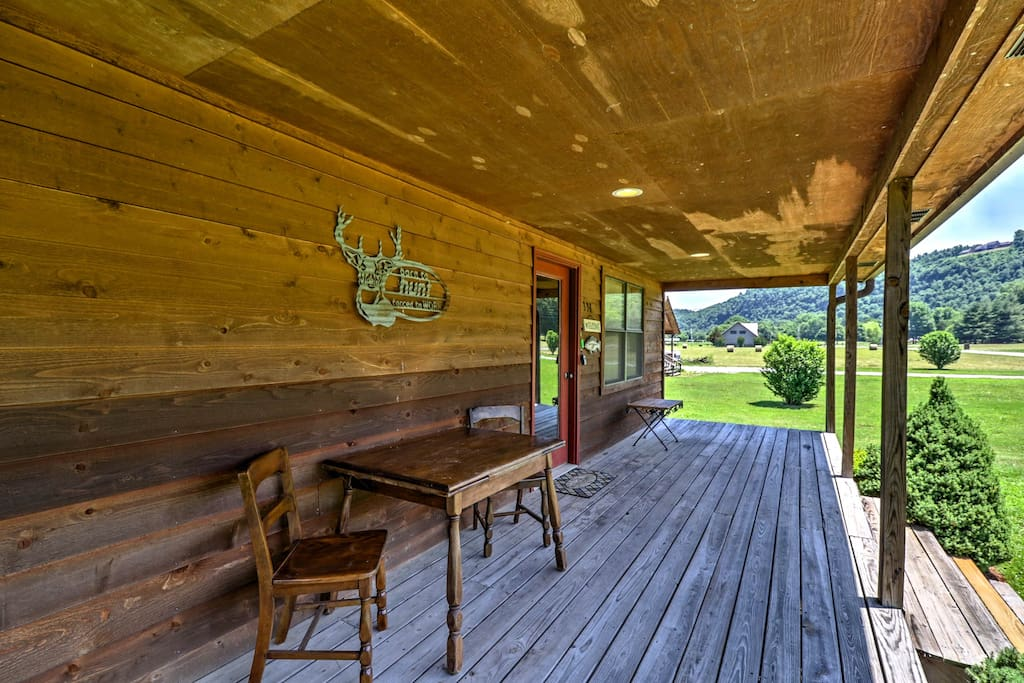 The cabin has 2 bedrooms, a loft, 2 bathrooms and a large porch.