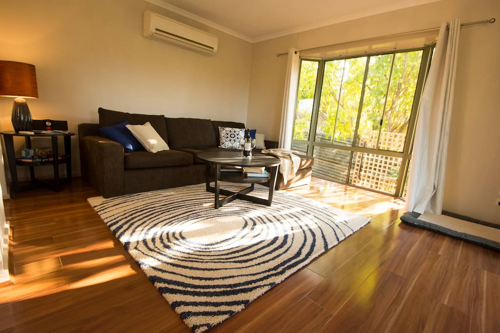 Living area, North-West large bay window, Air Con