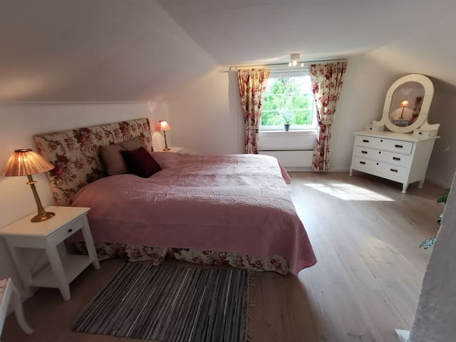 Bed room 1 upstairs with its romantic and cozy style will give you sweet dreams and a relaxing sleep.