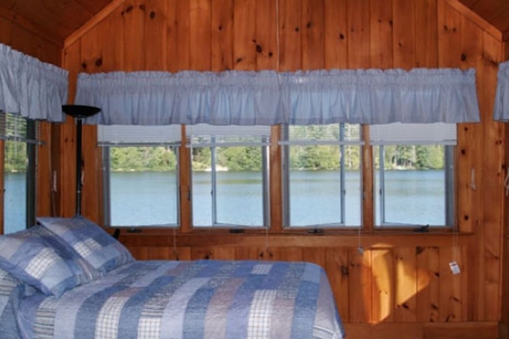 Enjoy amazing lake views from the bedroom.