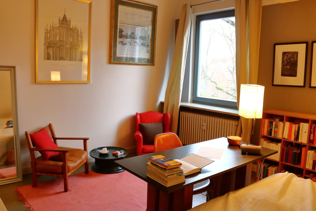 desk and armchairs are provided for a pleasant stay