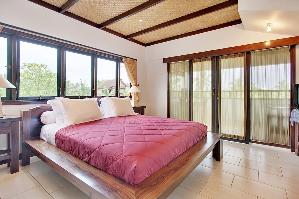 Open the new black out curtains ( not in this photo ) and expect to catch a few sunrises from the comfort of your entrance floor king room.. with private balcony, day bed table and chairs.