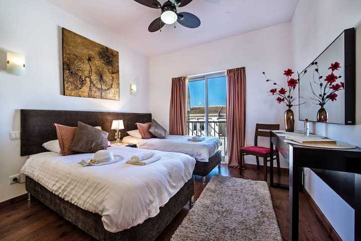 A warm and inviting bedroom with twin beds