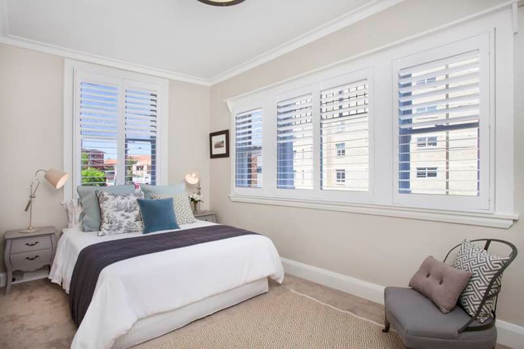 Bright Master Bedroom overlooking water views. Plantation Shutters for privacy.