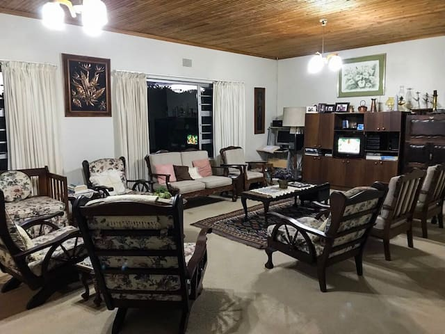 Large lounge area with television and DSTV. Ideal for hosting guests or relaxing after a day on the beach.