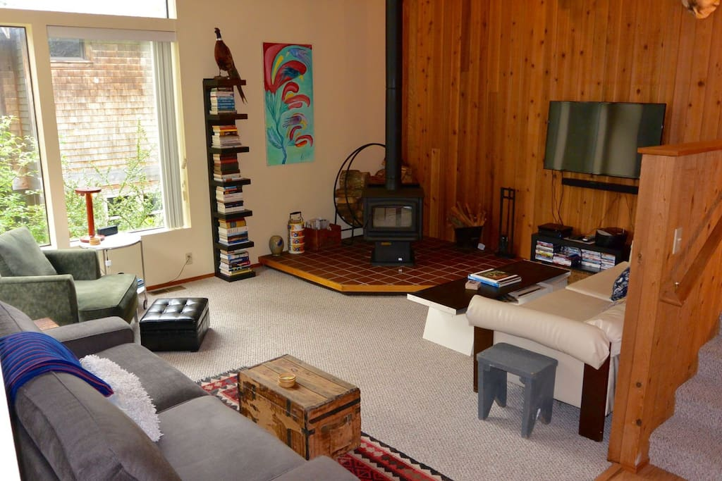 The living room has a wood burning fireplace wood provided