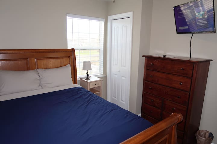 1A Private Queen  bedroom in a shared space.