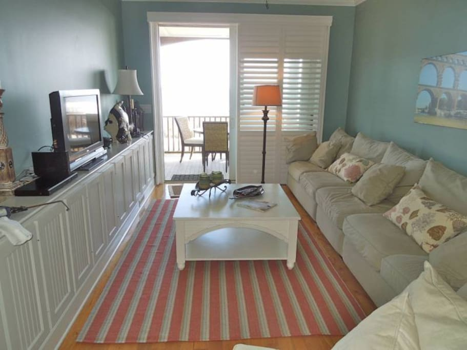 the gathering room is perfect for reading a book, visiting with family/friends, or watching television while an enjoying a beautiful view of the ocean