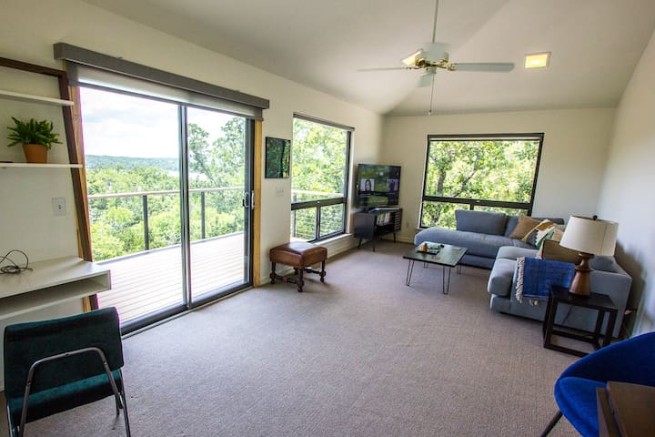 Upstairs living area has plenty of windows and access to the upper deck